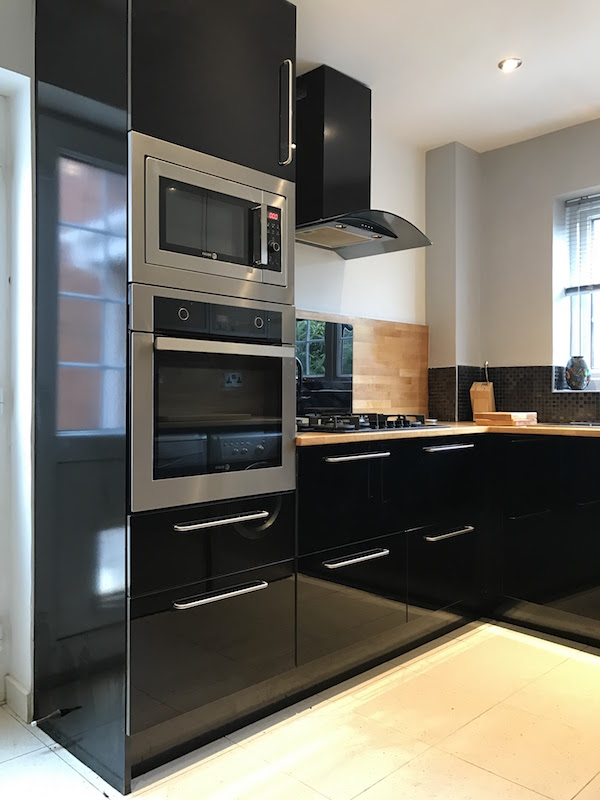 Black high gloss kitchen with slimline pantry kitchen city for Black gloss kitchen ideas